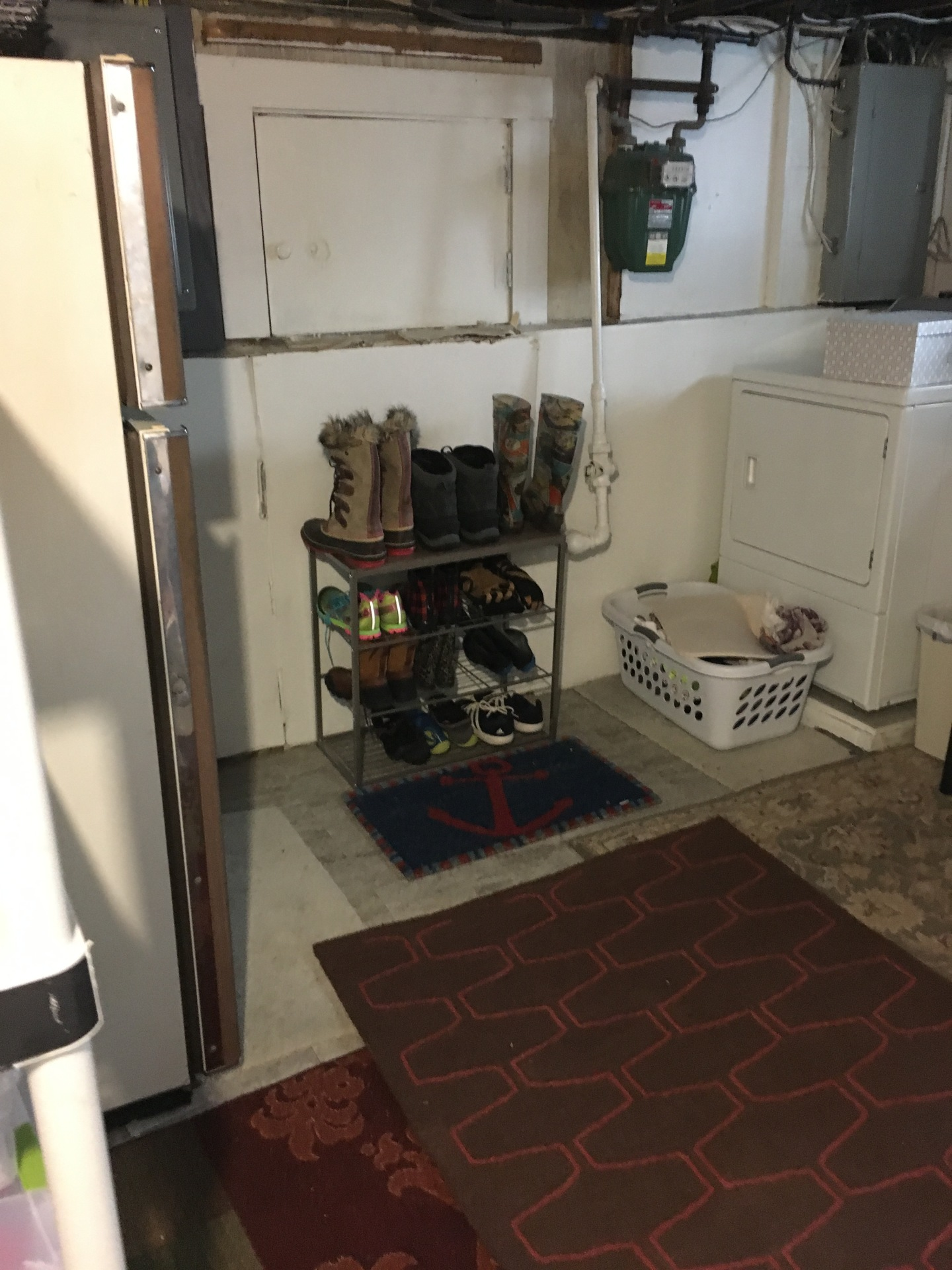 "Once we got rolling, she finally found a place to have a ""mini mudroom"".  So even the rain boots have somewhere to go!"