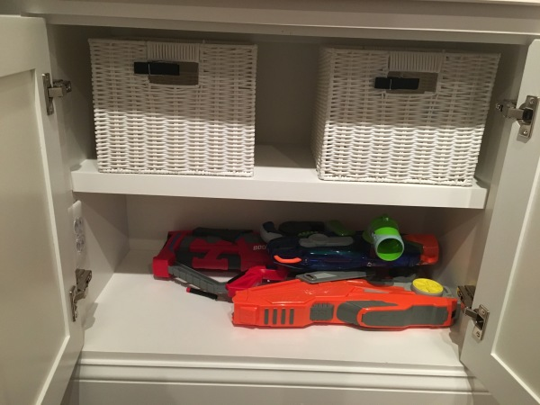 "I get sick of looking at Nerf Guns.  So glad we found a spot to ""hide"" them!"