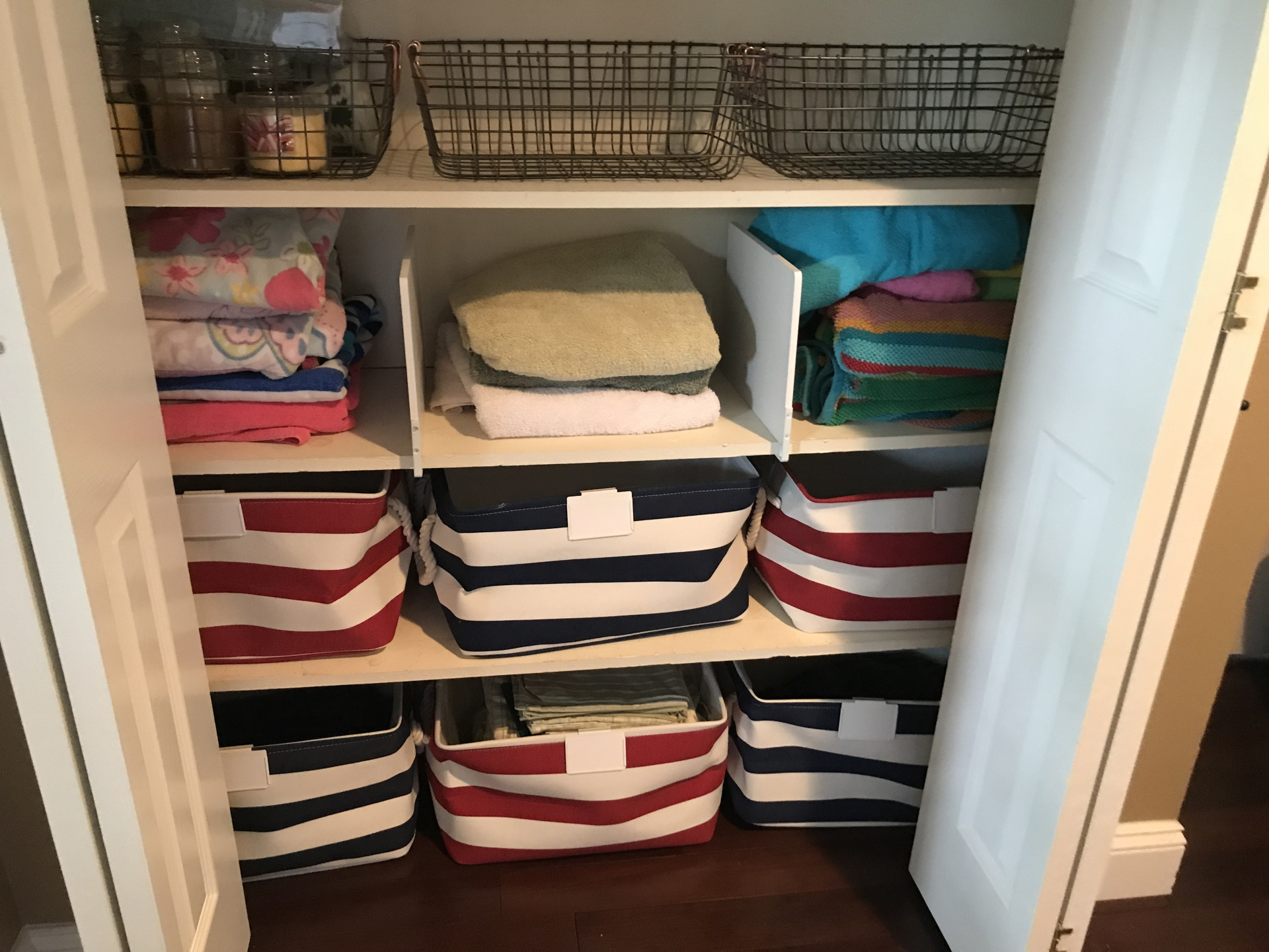 SHEETS!  In those beautiful striped baskets!  And towels neatly separated with shelf dividers from Target.