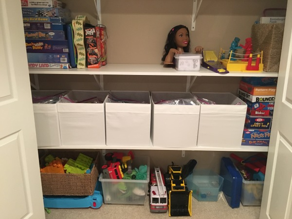 ALL of her board games are in those bins! What a space saver!