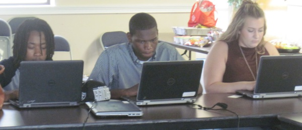 College Planning Cohort students engaged in scholarship research