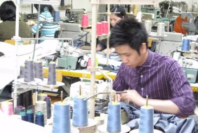 Joey Dimz on sewing machine