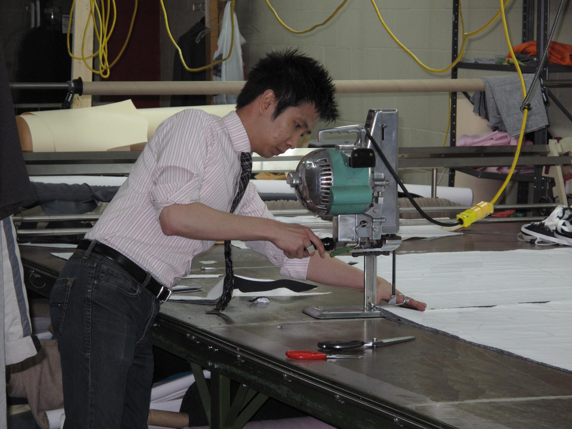 Master Tailor Joey Dimz Cutting Fabric