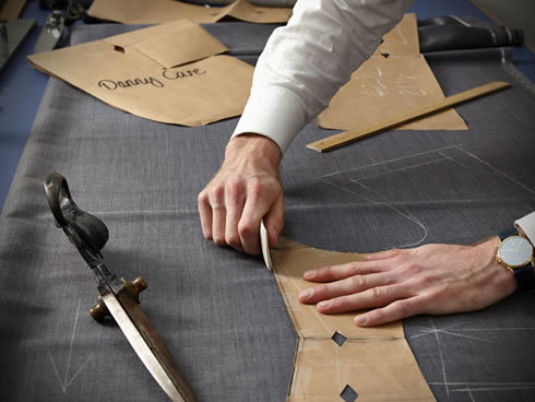 A Tailor making suit patterns
