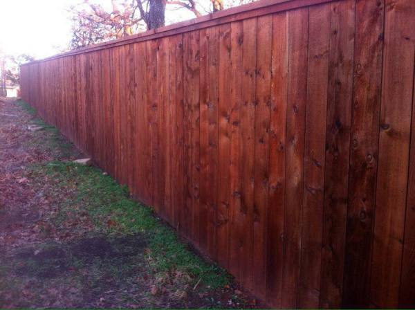 Residential Stained Cedar Cap and Trim Privacy Fence Edmond Oklahoma Fence Gate Company