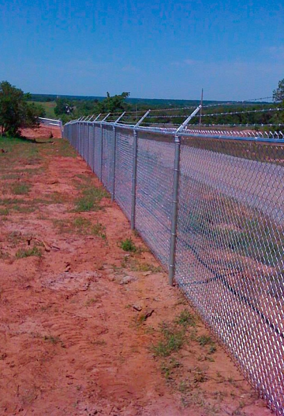 Commercial galvanized chain link fence with 3 point barbwire Edmond Oklahoma Fence Gate Company