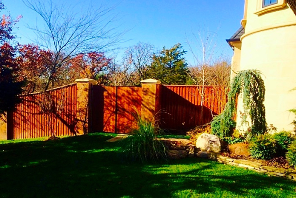 Residential Custom Cedar Cap and Trim Stained Privacy Fence Edmond Oklahoma Fence Gate Company