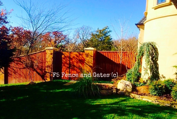 8 ft Cedar Cap and Trim Stained Privacy Wood Fence