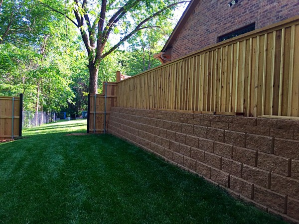 Cedar Cap and Trim Wood Privacy Fence with Bats Edmond Oklahoma Fence Company