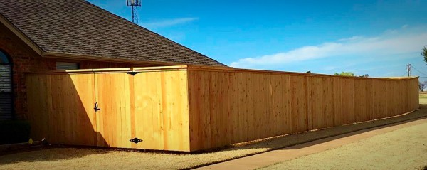 Residential Cedar Cap and Trim Wood Privacy Fence on Steel Posts and Walk Gate Edmond Oklahoma Fence Gate Company