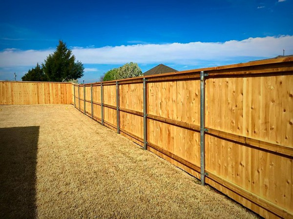 Residential Cedar Cap and Trim Privacy Wood Fence on Steel Posts Edmond Oklahoma Fence Gate Company