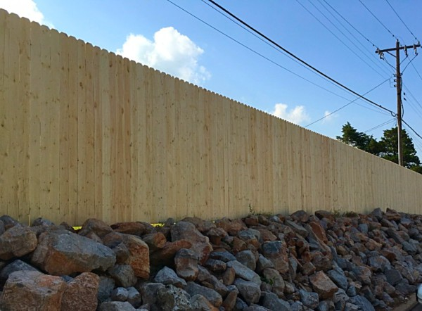 Commercial Use of Stockade Dog Eared Privacy Wood Fence Edmond Oklahoma Fence Company