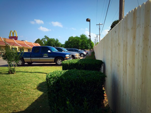 Commercial Stockade Wood Fence for McDonalds Edmond Oklahoma Fence Company