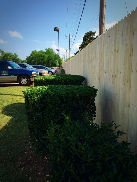 Commercial Wood Stockade Fence on steel posts Edmond Oklahoma Fence Gate Company