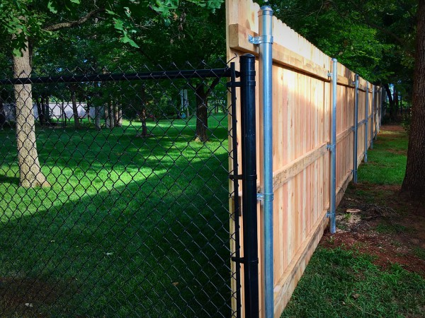 Residential Privacy Stockade Wood Fence combined with Black Vinyl Chain Link Fence Edmond Oklahoma Fence Company