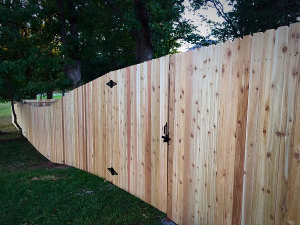 Wood shop and house fence with 7/8 cedar picket in Edmond Oklahoma Fence Company on steel posts, concrete and custom walk gates
