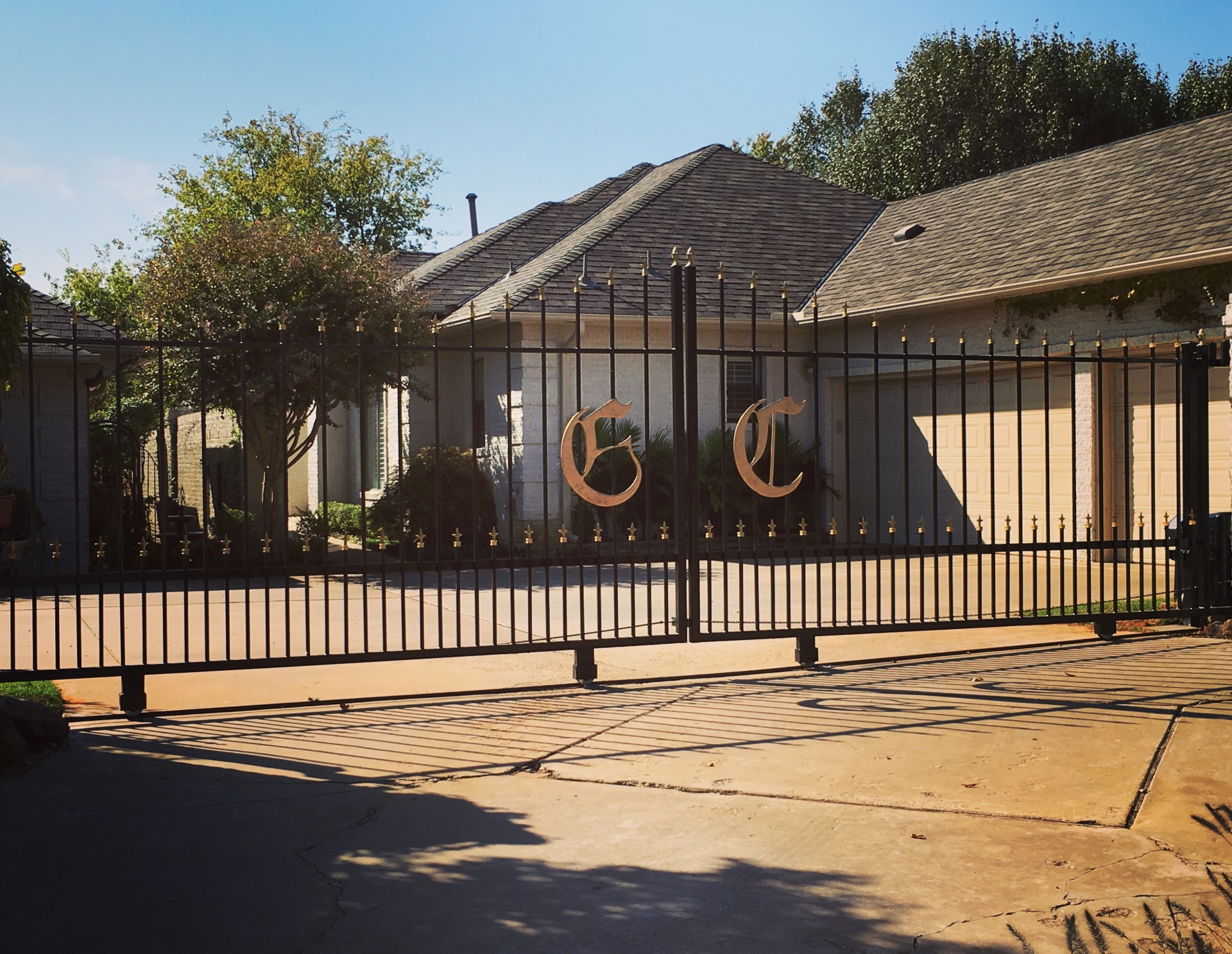 Edmond Oklahoma Fence and Gate Company Security Double Iron Gate with Gate Opener Entry Access System Iphone Wireless Smart Phone Capable Emergency Shut Off Alarm Remote Keyless