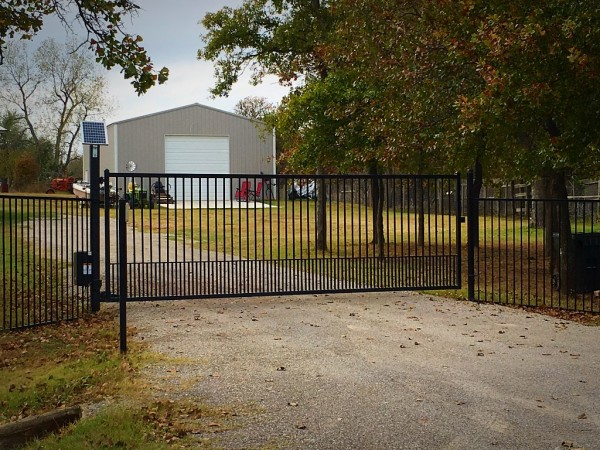 Economic Swing Gate Solar Entry Gate Basic Gate Basic Security Gate Poodle Picket Flat Top Custom Iron Gate with Automatic Gate Opener Edmond Oklahoma Fence and Gate Company Entry Access Security System