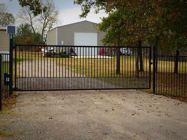 Economic Swing Gate Basic Gate Basic Security Gate Poodle Picket Flat Top Custom Iron Gate with Automatic Gate Opener Edmond Oklahoma Fence and Gate Company Entry Access Security System