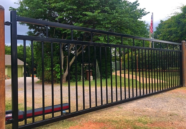 Economical Black iron gate solar power gate opener fence company local edmond gates security