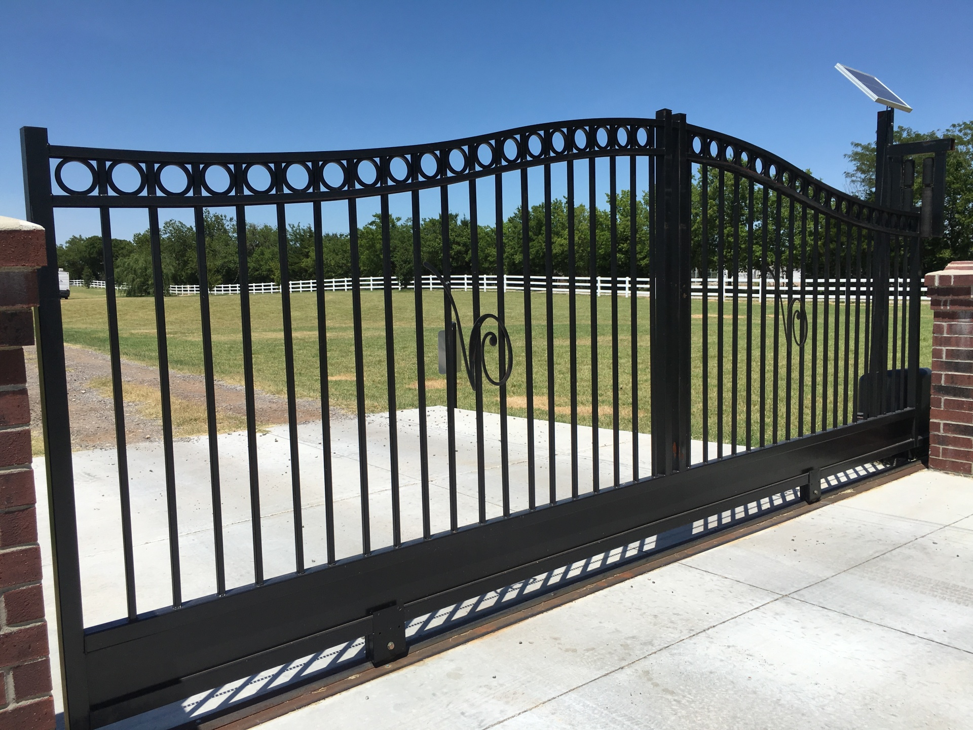Beautiful - Iron Driveway Gate - Gate opener - slide gate - solar access - edmond fence company - oklahoma fence
