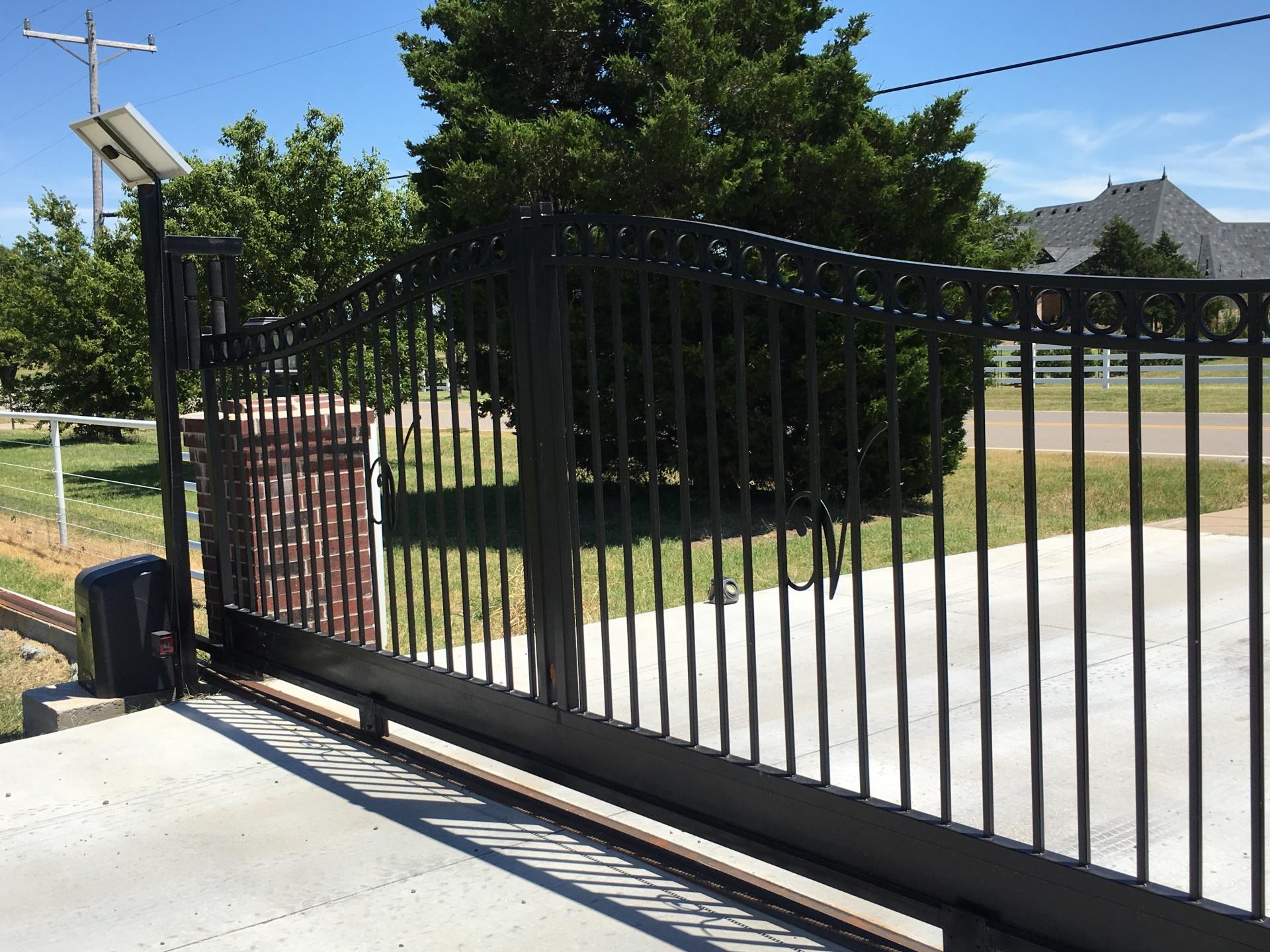 Beautiful - Iron Driveway Gate - Gate opener - slide gate - solar access - edmond fence company - oklahoma fence