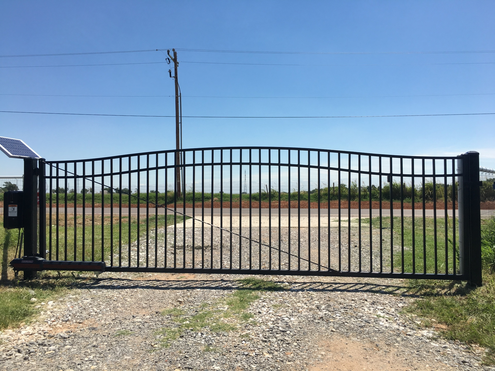 Economical Gate - Edmond fence and gate company - solar openers - gate access - security gates - custom iron gates - driveway gate opener - local oklahoma company