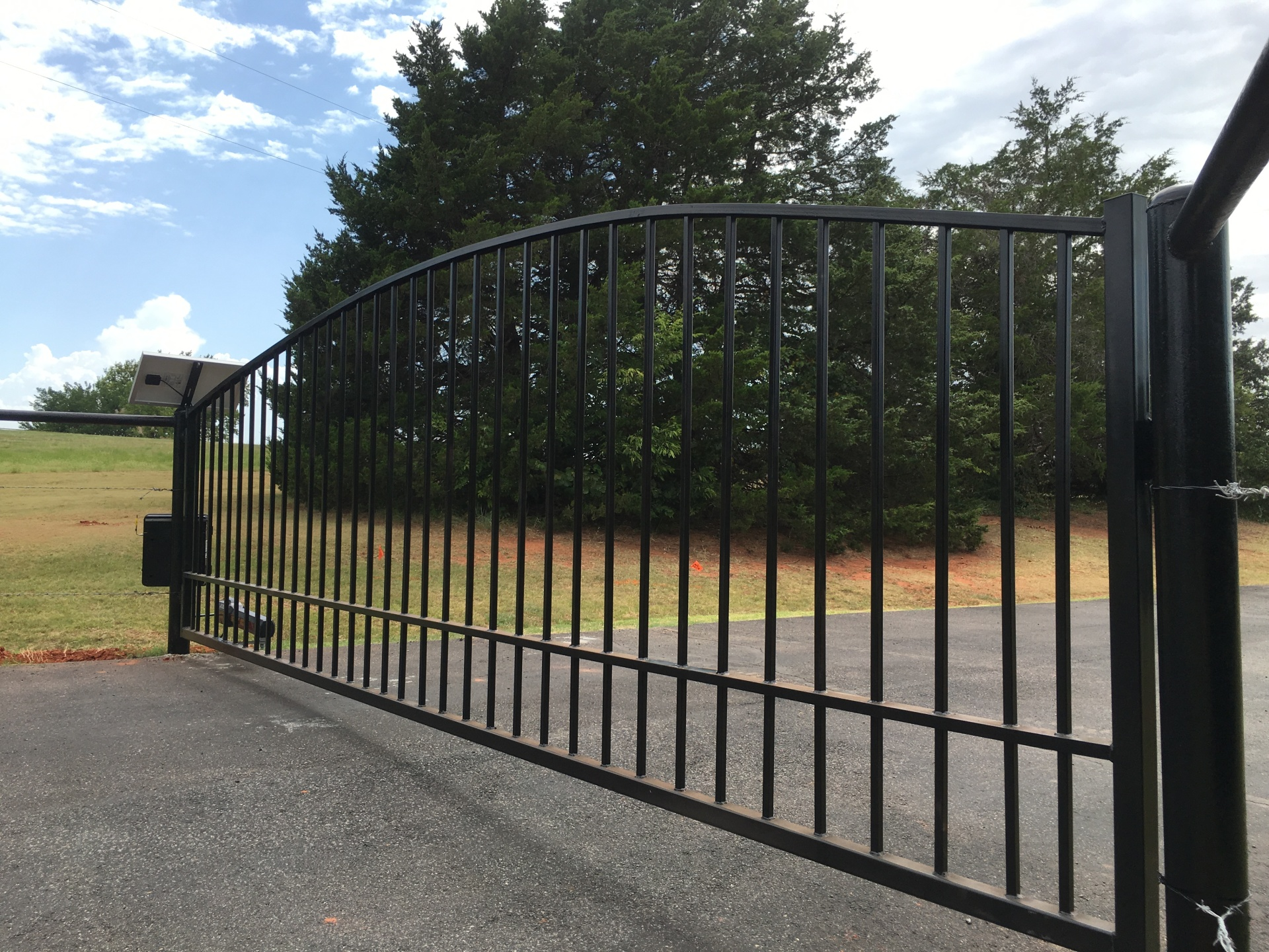 Single Black Iron Arch Top Solar Swing Gate with Liftmaster LA500 Edmond Fence Gates Company Estimates Security