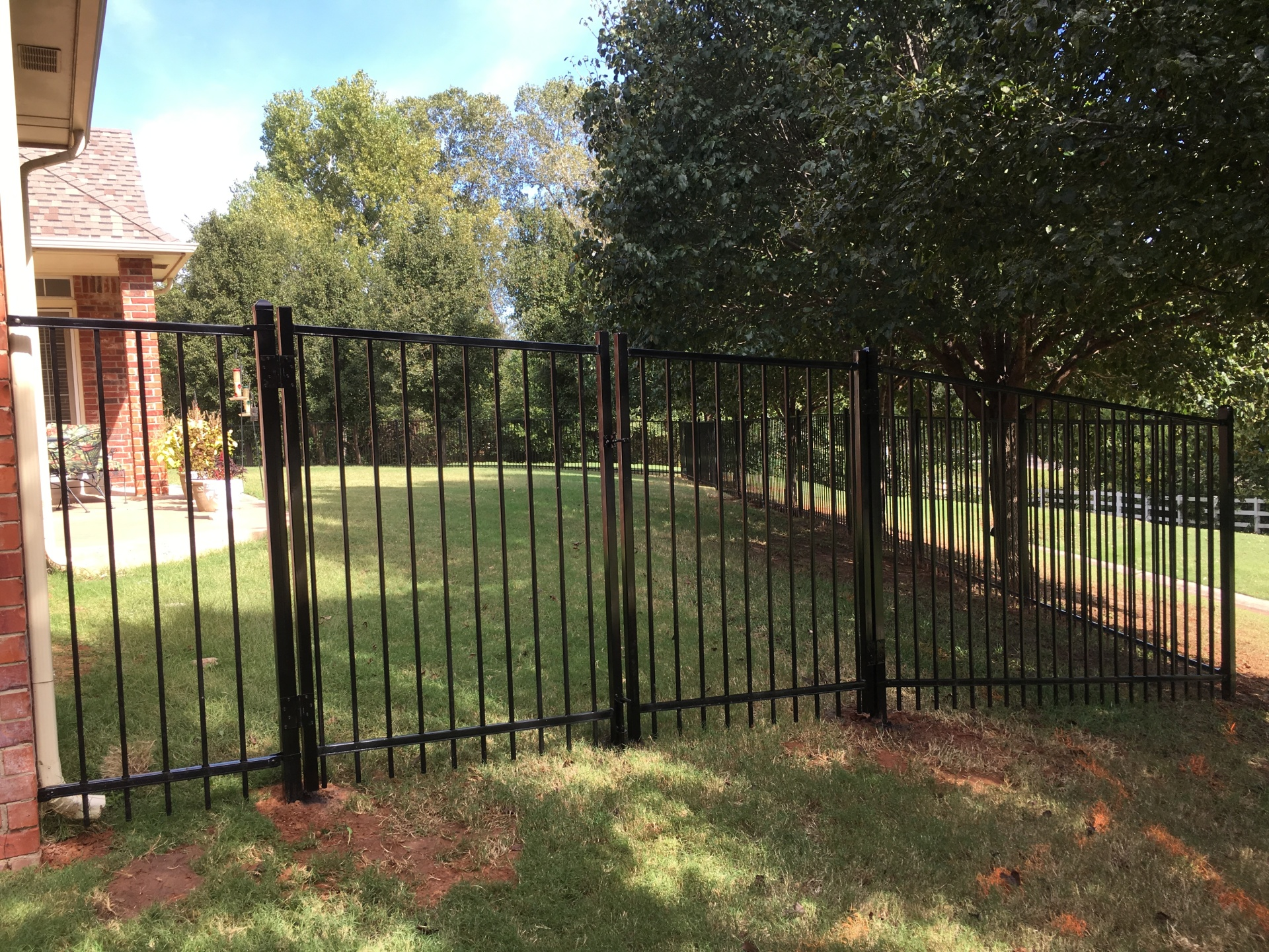 Double Iron Gates, Backyard fence, dog fence, secure, security fence, fencing, Oklahoma fence company, Iron fence company, Edmond Fence Company
