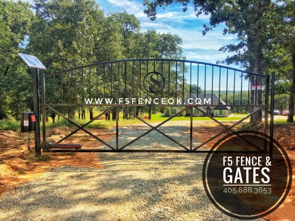 16' Single Swing Bell Arch Solar Powered Custom Iron Driveway Gate Liftmaster LA500 Edmond Fence Company Edmond Gates Powered Security System