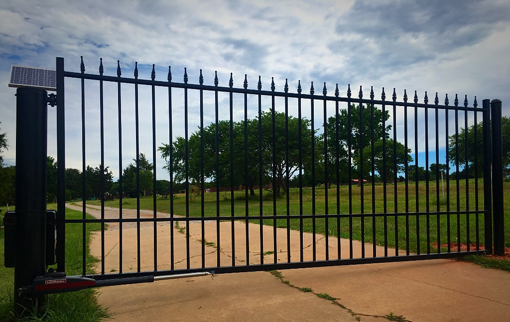 Edmond Gate Company, Custom Iron Gates, Oklahoma Gate Company, 14' Flat Top with Finial Design Single Swing Gate Liftmaster LA 412 Solar Setup Custom Driveway Gate with MyQ Internet Gateway Access System