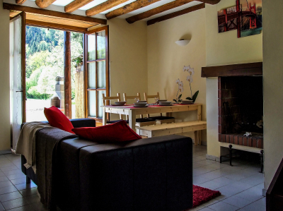 Livingroom with open fire, dining area and patio doors to the garden