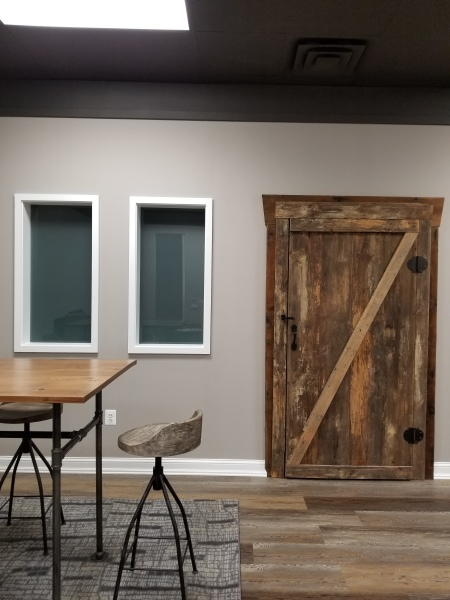 Barn door and custom oak top with pipe legs