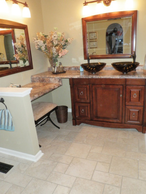 We complWe completely remodeled this bath, adding custom tile, a dual vanity,, lighting, flooring, and more!etely remodeled this bath, adding custom tile, lighting, flooring, and more!