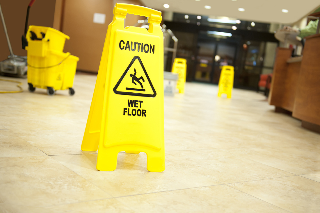 caution sign on wet floor