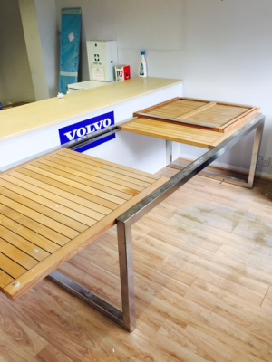 Teak and stainless table with extedable centre