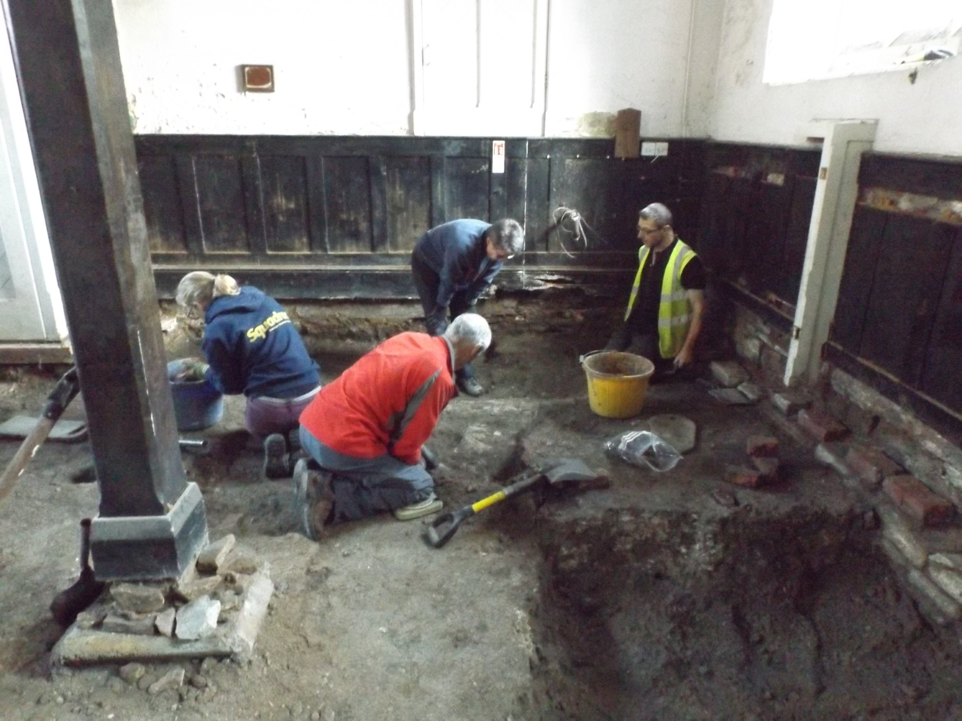 Volunteer excavation led by Avon Archaeology within the School Room