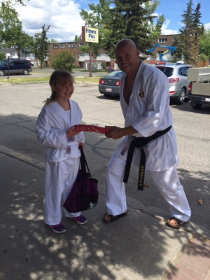 Emily receiving her Red Belt