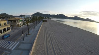 A photographic view along the early morning empty beach at Port de Palenca, Majorca. Taken by a drone from height