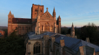 An early morning photo of St Albans Abbey, Sumpter Yard end, taken using a drone level with the ground floor roof. The higher roof level and bell tower dominate the photograph