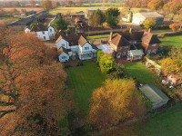 An aerial view of the rear of a house, taken using a drone, to really show of the back of the house and garden