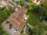 Aerial photograph looking down on a house taken by a drone, like a birds eye view