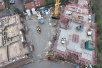 Aerial view from above of a construction site, looking directly down, like a birds eye view. Taken using a drone