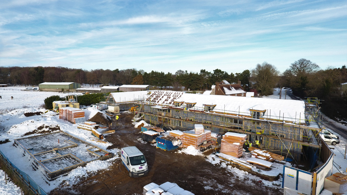 Drone taken aerial photograph of a building site in the snow