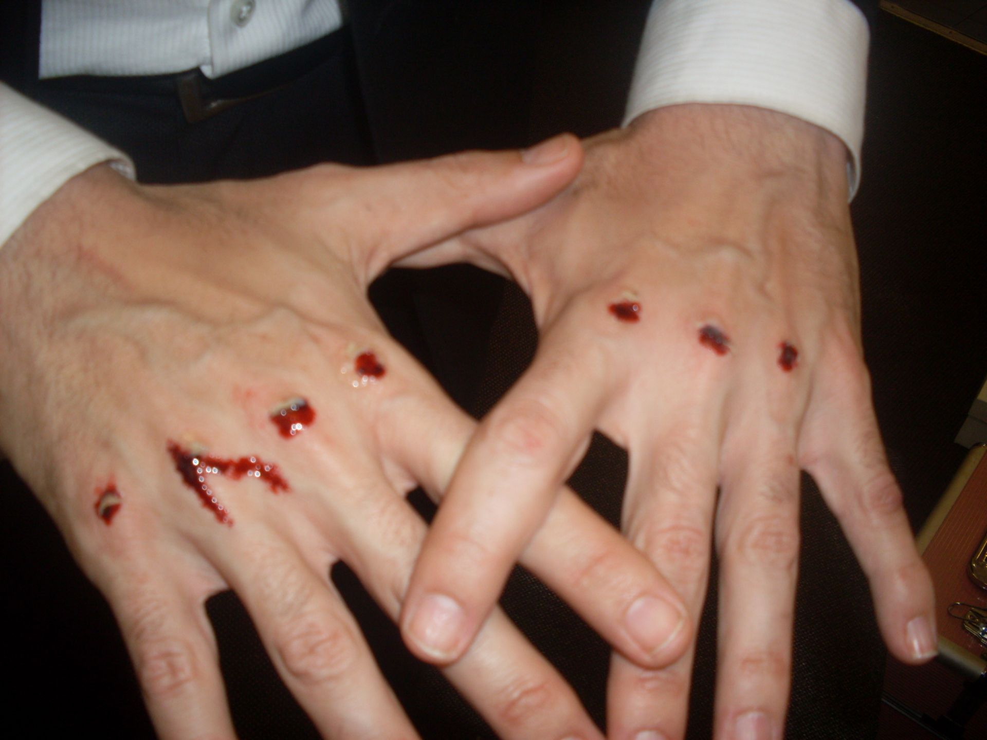 man hands with movie makeup and special effects