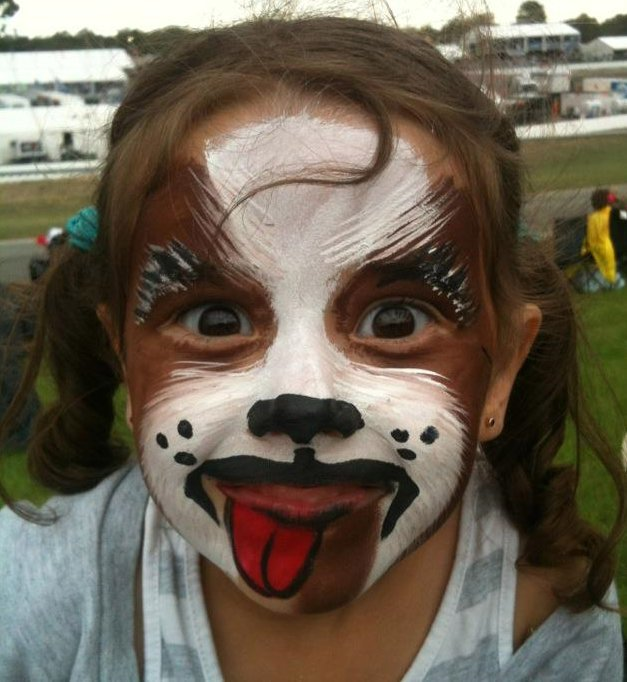 child with puppy facepainting