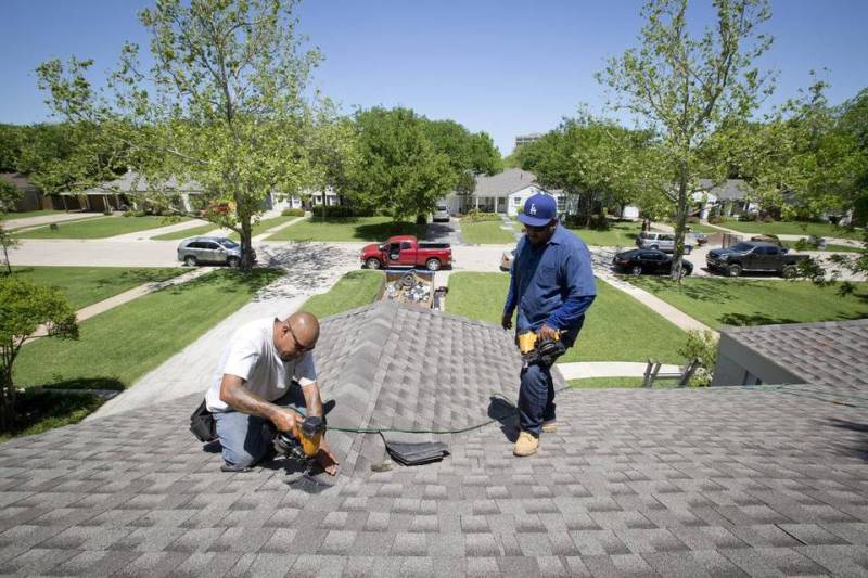 Public adjusters help homeowners negotiate settlements with insurers for repairs like a new roof aft