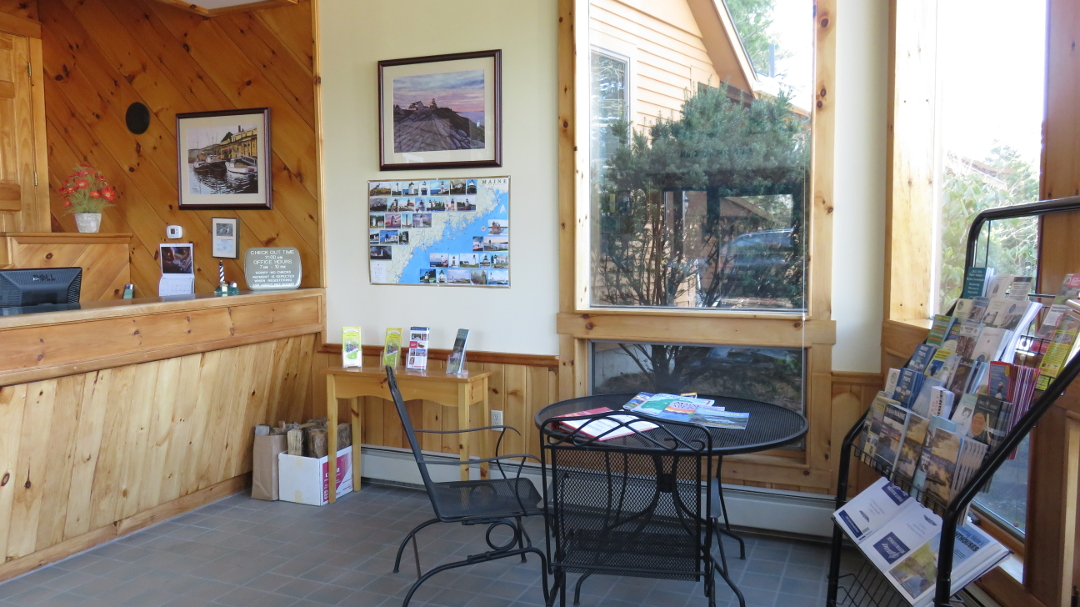 Beautiful lobby area with maps and handmade woodwork at Wiscasset Woods