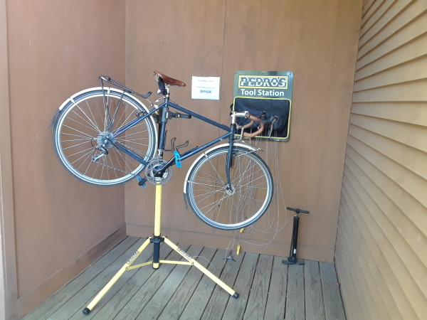 The bicycle shack provides indoor storage and repair stand for bicycles