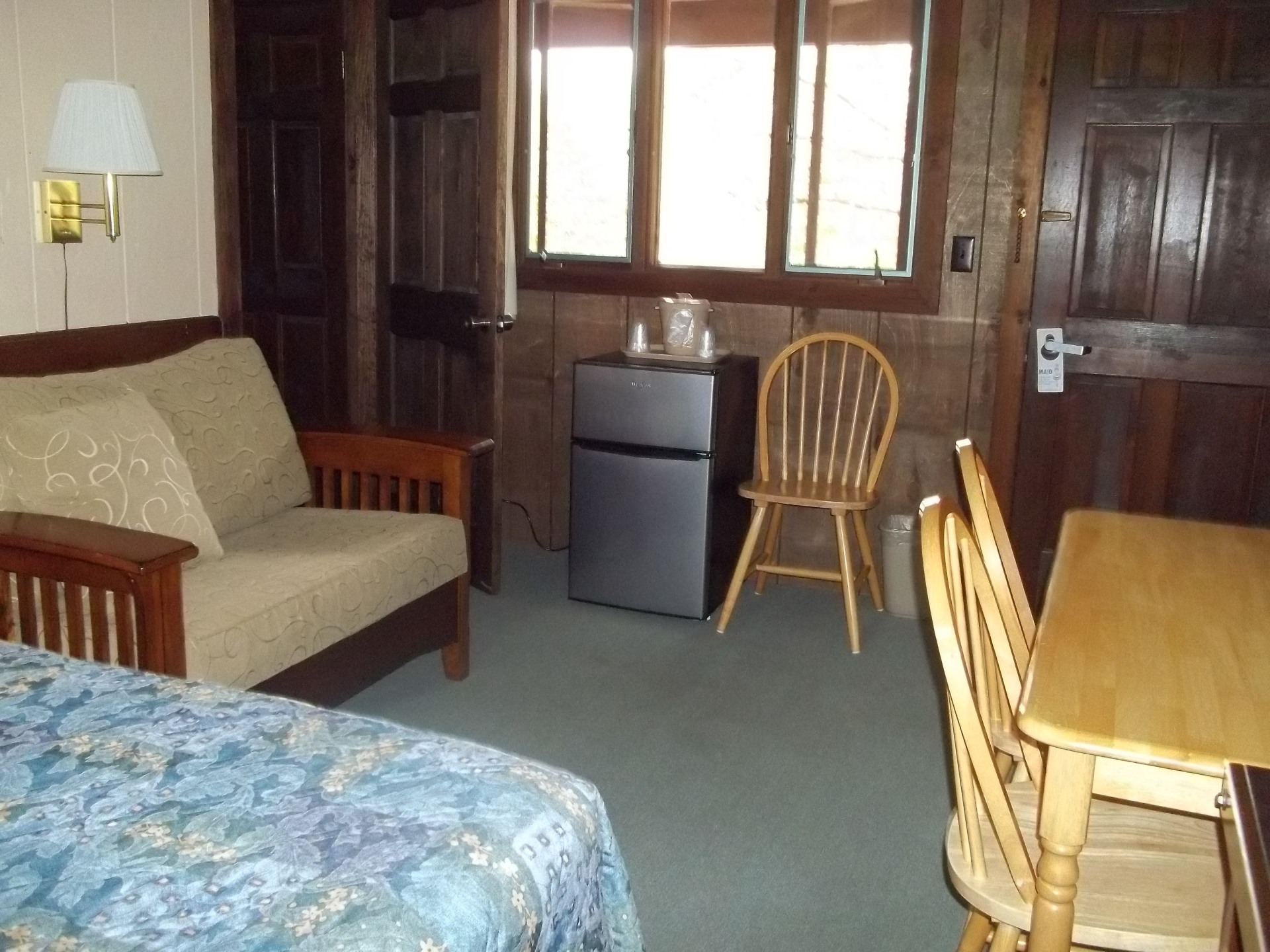 Full Bed and Fold Out Chair in Motel Suite